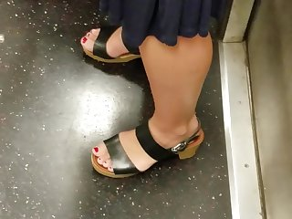 Candid feet of mature milf