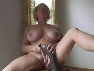 Hot blonde MILF masturbating with big..