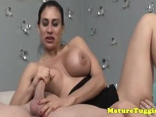 Glam milf tugging a cock with her..