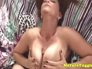 Busty milf sucking balls and tugging cock