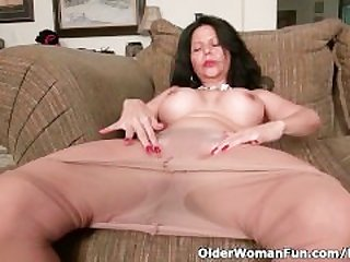Busty milf April White peels off her..