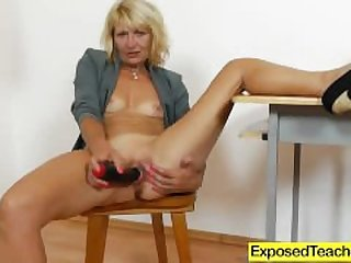 Curvy milf riding a huge fake penis