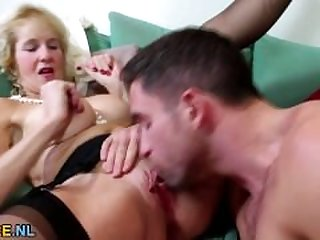 Big boobed blonde mature bouncing on a..