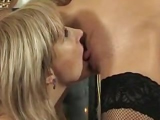 MILF rides on lesbian with strapon