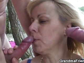 Blonde old women swallows two cocks..