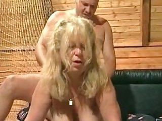Younger dude fucks blonde granny