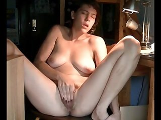 Mature plays with hairy pussy