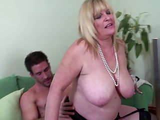 Big breasted old mom enjoying young big..