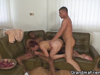 Granny swallows hard two cocks at once