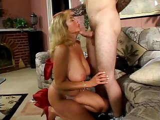 Big titted mom has a young lover