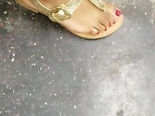 Candid ebony feet with red toes