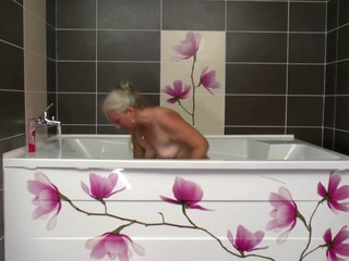 Old mom takes young cock in bathroom