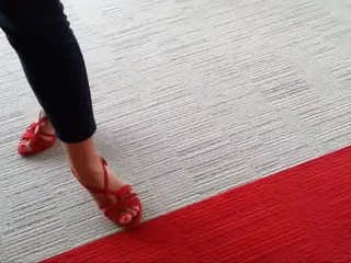 Friend's feet in red heels 1