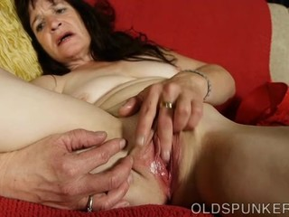 Beautiful mature brunette fucks her..