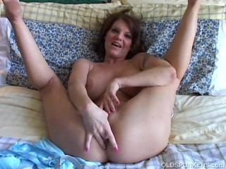 Busty old spunker loves to play with her..