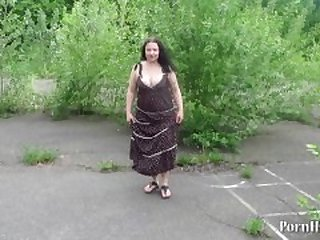 mature woman urinating in a public place